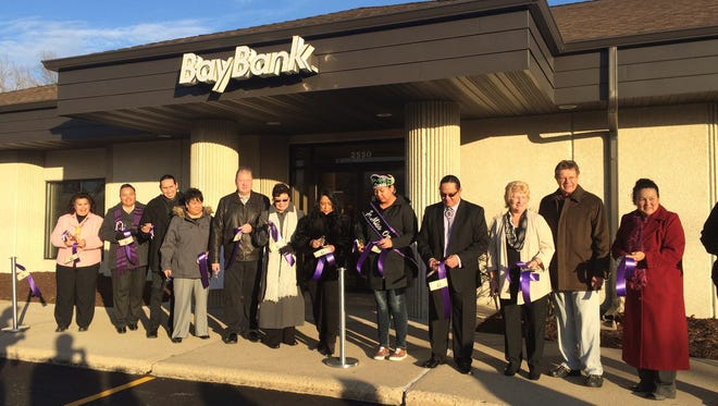 Bay Bank employees and Oneida Nation representatives cut the ribbon Tuesday on the new branch of the Oneida-owned Bay Bank at 2550 W. Mason St.