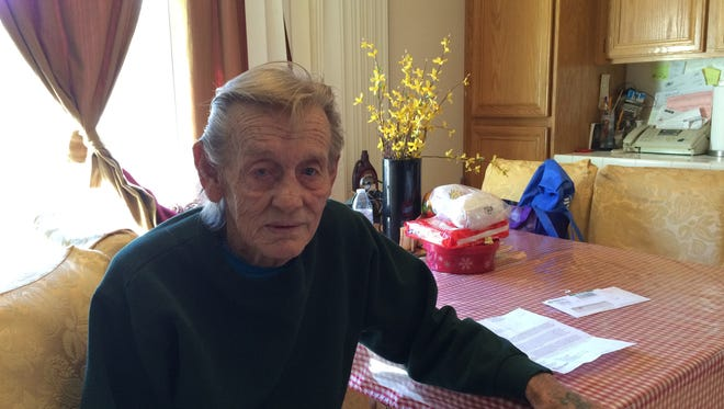 US Navy Veteran Ray Bentley sits next to the letter he received warning about possible TB exposure.