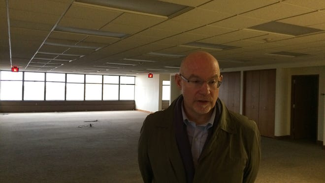 Boerke Company Principal Jack Price shows off the seventh floor of the US Bank building complex on Pine Street on Tuesday.