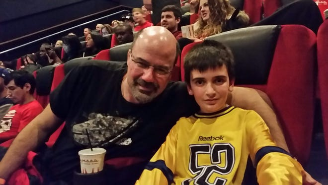 """James and Jeffrey Pilcher get ready to take in """"Star Wars The Force Awakens"""" Thursday night."""