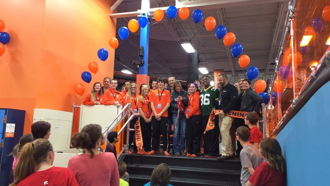 Sky Zone staff, plus former Green Bay Packers player LeRoy Butler in his No. 36 jersey, gather for the Sky Zone Trampoline Park's ribbon cutting on Jan. 29.