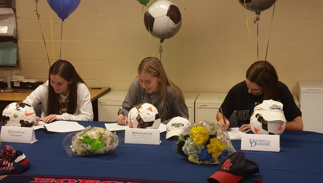 From left, Kelsey Goldring, Carly Barnett and Jessica Kennett sign their national letters of intent at Byram Hills High School on Wednesday, February 3rd, 2016.