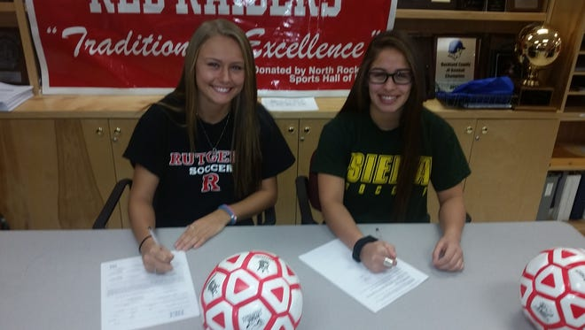 Taylor Aylmer (left) and Amber Alfonzo sign their national letters of intent at North Rockland High School on Wednesday, February 3rd, 2016.