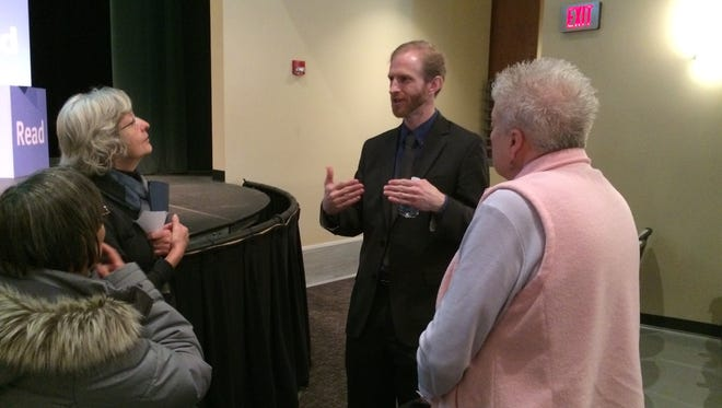 """Rob Grunewald talks with community members who attended """"Baby Business"""" following the event Wednesday, Feb. 10, 2016."""