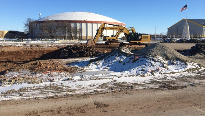 An underground storm water detention tank is under construction in the east parking lot of Lambeau Field on Feb. 11, 2016.