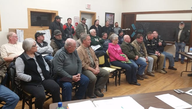 Door County Sheriff Steve Delarwelle, seated at the far right in front row, explained the lack of manpower and inability to enforce regulations on to ATV operation on pave roads to enthusiasts seeking the Gardner Town Board's adoption of an ordinance legalizing the practice.