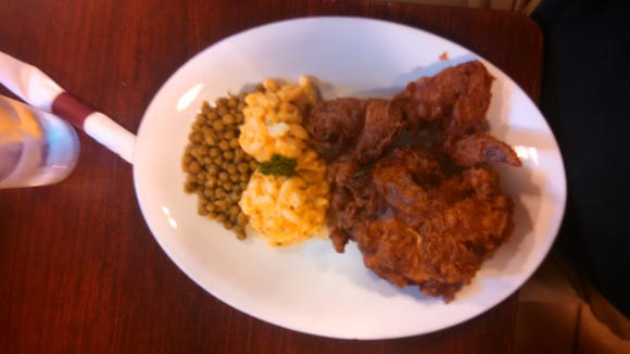 Fried chicken with a side of macaroni and cheese mixed with peas at Willie Mae's Scotch House, New Orleans.