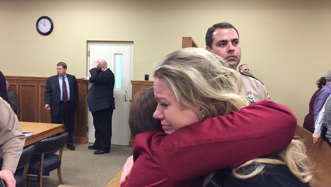 Stacy Maciuk, right, hugs Assistant District Attorney Linda Walls on Monday after Clayton Rogers was sentenced to 12 years in prison after he pleaded guilty to vehicular homicide by intoxication in October for the death of Dr. Eric Raefsky.