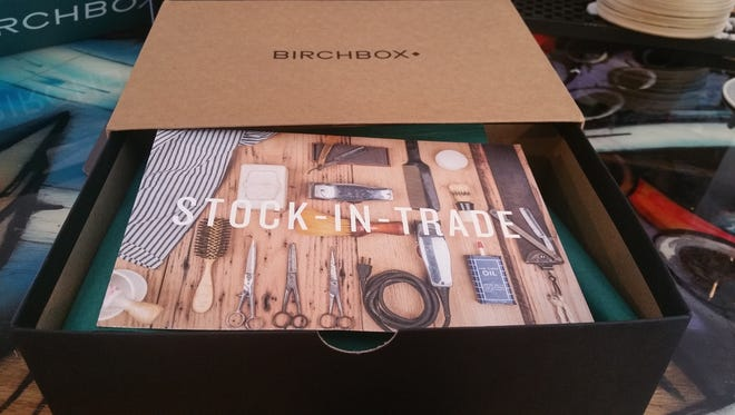 The drawer style box of Birchbox reveals a postcard describing the contents inside.