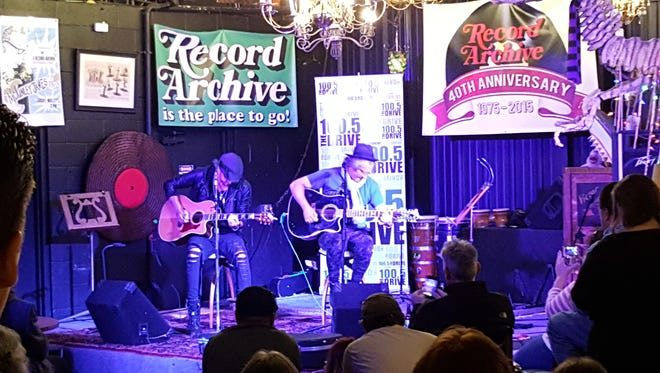 Ed Roland, right, and Jesse Triplett played a seven-song free show for about 100 people on April 1 in The Record Archive's retro-infused back room in Rochester.