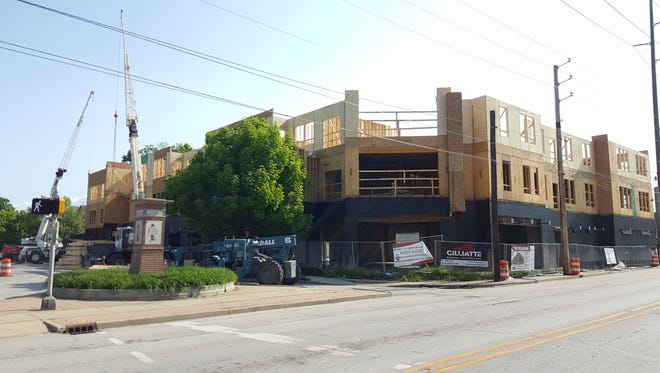 Construction continues on The Delaware, a mixed-use development at the corner of East 22nd and Delaware streets slated to open in August.