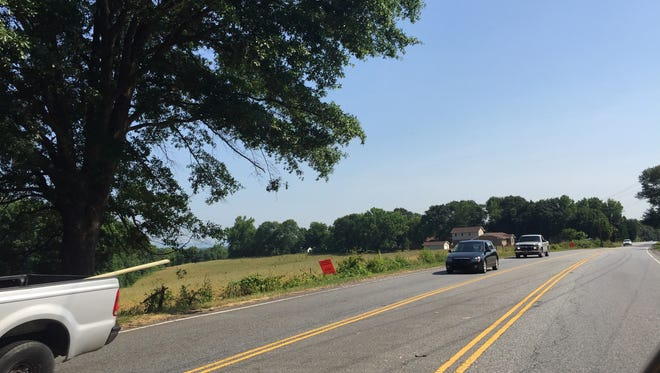 An orange notice about a proposed subdivision near the Eastside YMCA shows through traffic on Brushy Creek Road.