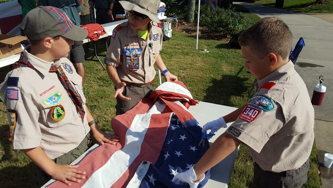 More than a dozen local Boy Scouts participated in a ceremony to retire American flags. The Scouts have been collecting flags from all over the community. Each year they gather more than a thousand torn, tattered or damaged flags to be properly retired.