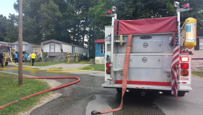 Firefighters responded to a fire this afternoon at Rolling Acres Mobile Home Estates, off North Highland Avenue.