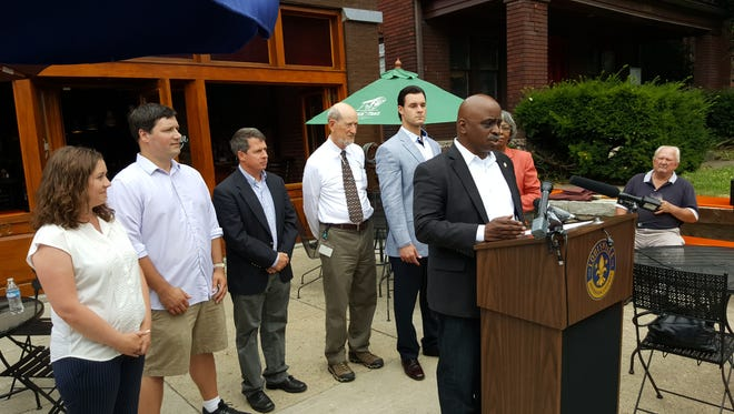Metro Council member David James speaks at a news conference Friday outside Old Louisville Tavern.