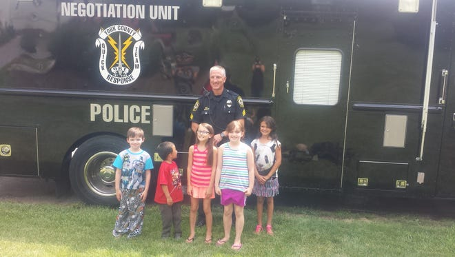 Sgt. Ken Schollenberger spends time with children in Newberry Township following a six-hour standoff in their neighborhood. One neighbor, Alisha Jenkins, posted on social media that she wanted to share some positive news about community police officers. Sgt. Schollenberger is a member of QRT and York Area Regional Police.