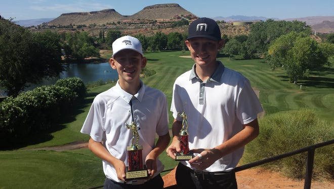 Brothers Luke (left) and Noah Schone pose for a picture after playing in their first tournament together at Dixie Red Hills on Tuesday.