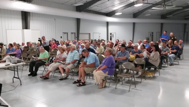 About 100 people attended Monday's public forum at the Kewaunee County Fairgrounds regarding a proposed county sales tax.