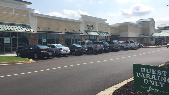 The developer and owner of Riverside Crossing expects retail outlets to join Lowes Foods in the shopping center by early October.