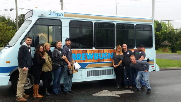 The Brew Bus NJ passengers from a past trip hang out outside the bus. Catch a tour and try a new NJ brewery.