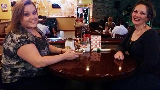 Emily Kelley and Amanda Debuty spend a night out at Swifty's Atomic Bar & Grill in Oak Ridge