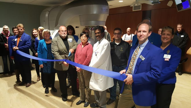 The Aurora Vince Lombardi Cancer Clinic in Sheboygan marked the end of a renovation project with a ribbon-cutting earlier this month. Sheboygan County Chamber Executive Director Betsy Alles is pictured with Mitchell Pincus, a radiation oncologist, cutting the ribbon. Also pictured are Qiaofang (Lisa) Chen, Santhosh Kumar and Chamber ambassadors and supporters.