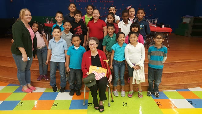 U.S. veteran Marilyn Dow with Sarah Vicker's second grade class at Berlanga Elementary School on Thursday. Vickers is also Dow's great-niece.