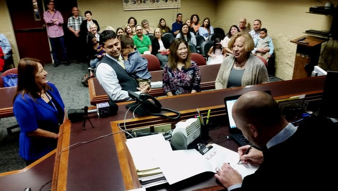 County Court at Law 5 Judge Timothy McCoy makes an adoption official Thursday, Nov. 10, 2016.