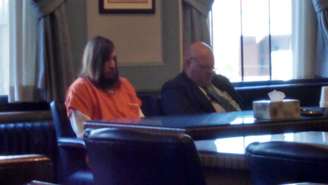 Brock D. Martin and his attorney Rolf Whitney waiting in court for a change of plea hearing in November.