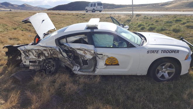 A Utah Highway Patrol vehicle was damaged Sunday when it was struck by a passing vehicle in Box Elder County.
