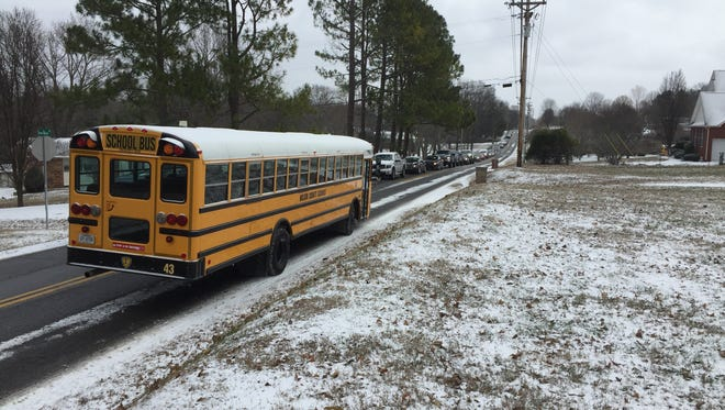 A Wilson County school bus leaves Lakeview Elementary Friday, Jan. 6, when the district dismissed early for snow.