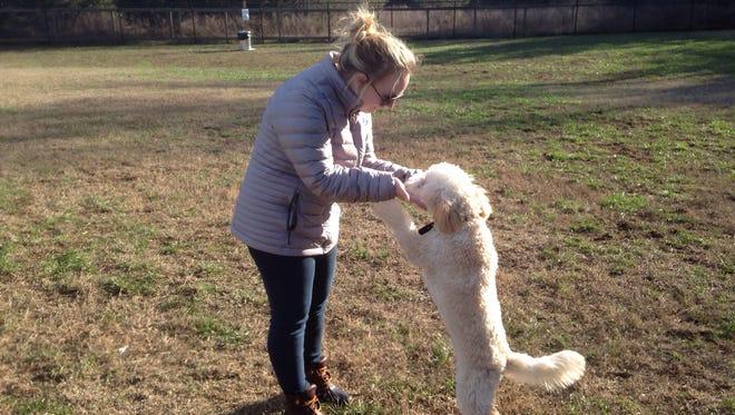 Karen Keopanya plays with her medium Goldendoodle, Obi-Wan, at the new dog park at the Cason Trailhead in southwest Murfreesboro.