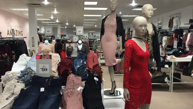 Charlotte Russe sells dresses through denims in its new Fox River Mall store.