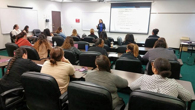 Ruth Castillo with the Education Service Center Region 2 delivers a presentation on the HOPES program for Child Protective Services case managers and employees on Feb. 9, 2017.