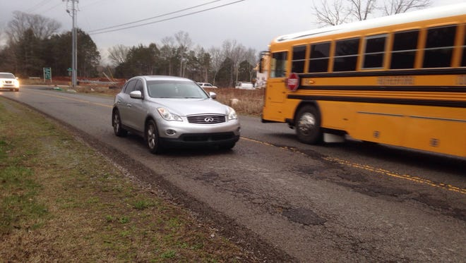 Commuters on Blaze Drive between Blackman High and Brinkley Road drive over many patched potholes.
