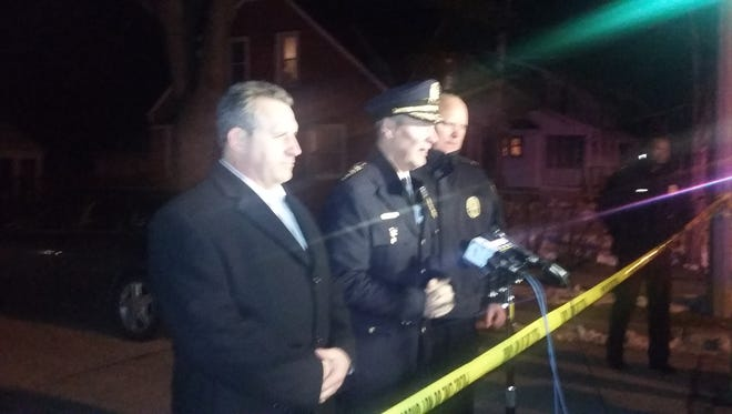 Milwaukee Police Chief Edward Flynn (center) prepares to address reporters at the scene of an officer-involved fatal shooting in the 4900 block of N. 19th Place.