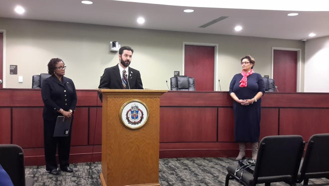 West York Mayor Shawn Mauck, center, speaks about the York City Human Relations Commission's move to West York, as York City Mayor Kim Bracey, left, and York City HRC Chairwoman Karen Rollins-Fitch look on. Tuesday, March 22, 2017. Jason Addy photo.
