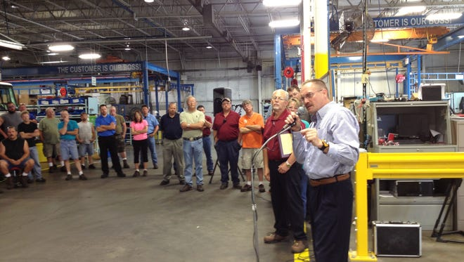 Autocar President Jim Johnston talks to employees during the celebration of the company's 10th anniversary in June 2013 in Hagerstown.