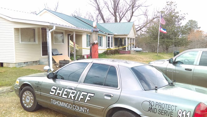 Law enforcement officials gather March 24 to investigate the death of Tishomingo Police Officer Russ Robinson.