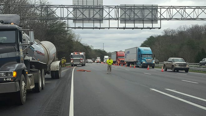 Two right lanes are blocked on Interstate 64 west in Indiana after a tanker bucked and spilled corn mash onto the highway.