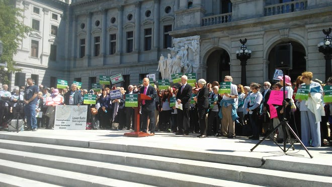 """State Sen. Mario Scavello, R-Monroe, speaks at an """"end gerrymandering in PA"""" rally on the Pennsylvania State Capitol steps. Tuesday, May 9, 2017. Jason Addy photo."""