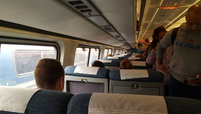 Amtrak riders board a rescue train after a Wilmington-bound Northeast Regional breaks down in Maryland