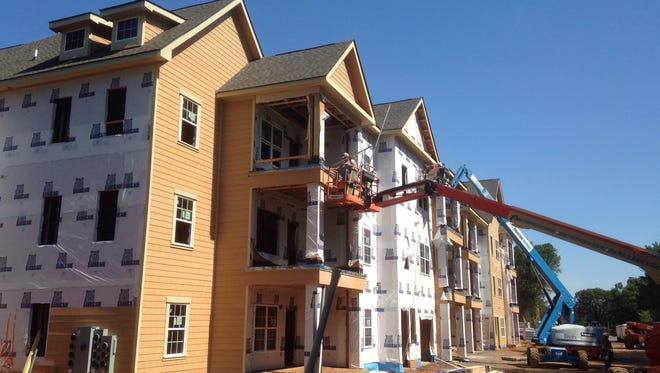 Crews work on Springfield Luxury Apartments, which will offer 270 dwellings on the north side of Manson Pike. City officials hope new residents moving to apartments and houses will complete a special census because a more accurate count will lead to an estimated increase of $2.9 million in state-shared revenues.