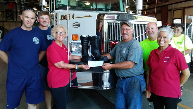 Fremont Elks Lodge No. 169 donated $750 to the Ballville Township Fire Department to purchase three new pairs of fireproof boots. The Fremont Elks also donated $3,500 to the Community Food Pantry and $2,500 for Free Beach Day and Family Fun Night at White Star Beach.