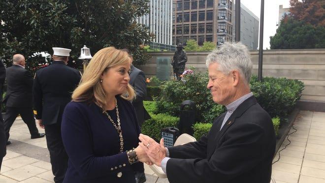 Nashville Mayor Megan Barry speaks with Catholic Dioceses of Nashville deacon and retired Nashville Fire Department Assistant Chief Jim Holzemer at a 9/11 memorial in Nashville on Sept. 11, 2017.