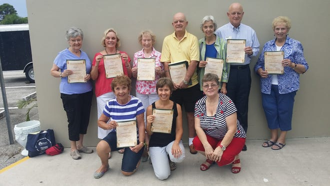 Members of the lip-reading class in Jensen Beach are presented with their certificates of completion.