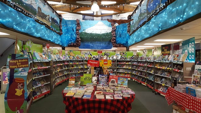 """The Stayton Intermediate/Middle School library became a campsite for the """"Happy Camper Book Fair."""""""