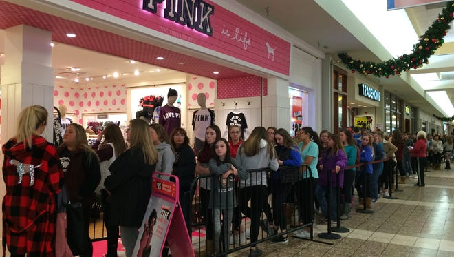 Stores are divided on opening Thanksgiving Day. Some stores that open get huge crowds. Pink, shown here in a 2016 Thanksgiving night photo, is in the Fox River Mall.