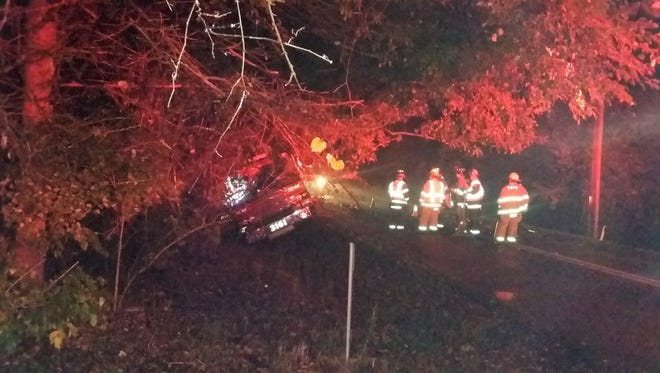 Firefighters talk near a town of Delafield fire truck that crashed while responding to a call around 2 a.m. Oct. 14 along Silvernail Road. An estimate of repair costs was not immediately available, but should be covered by the department's insurance.