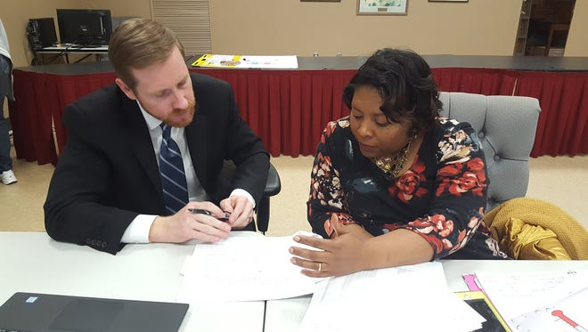 Jason Taylor, chief school financial officer for the Montgomery Public Schools intervention, (left) and Montgomery County Board of Education member Arica Watkins-Smith (right) at a budget work session on Nov. 15, 2017.